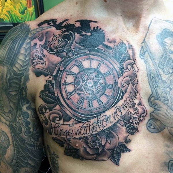 Great black and white antic mechanic clock with flowers and lettering tattoo on chest