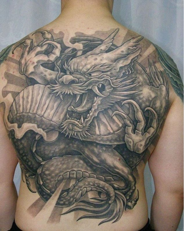 Great black gray japanese dragon tattoo on back