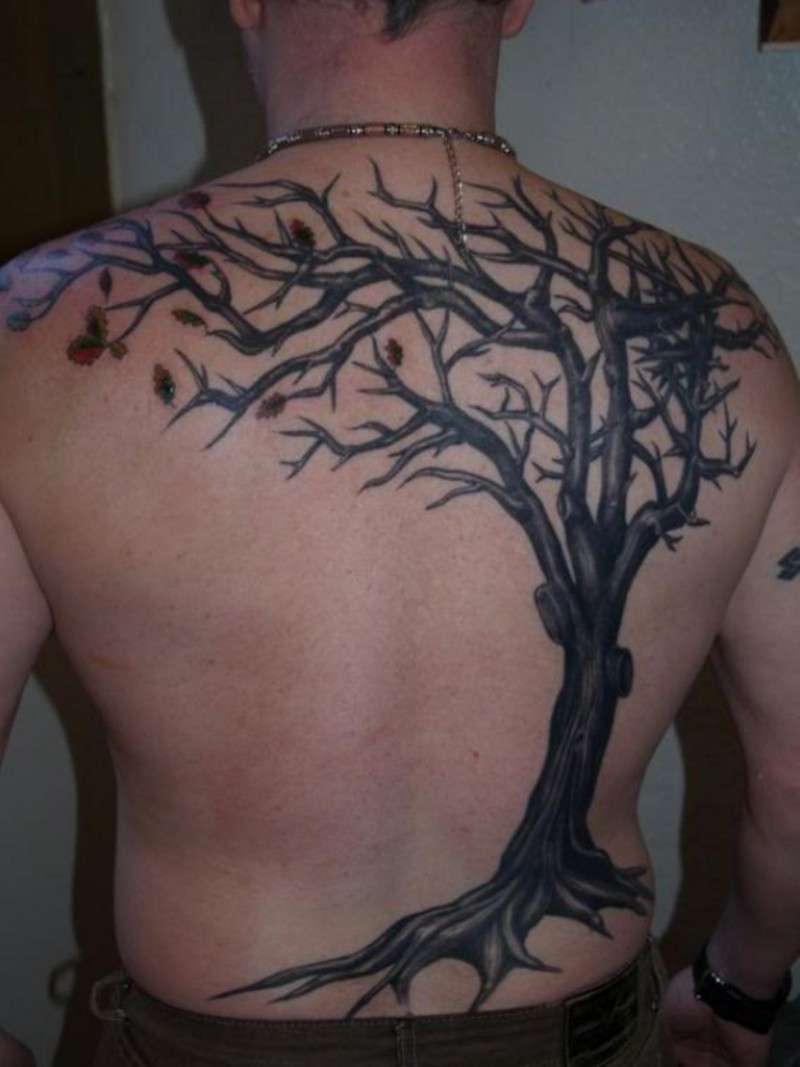 Great black tree tattoo on back