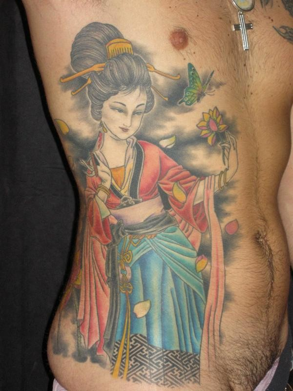 Great colored geisha with flower tattoo on ribs