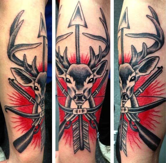 Great combined colored deer with crossed rifles and arrow tattoo on leg