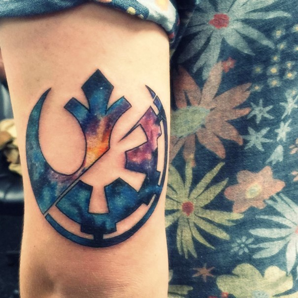 Great combined space themed half Rebel Alliance half Empire emblem tattoo on arm zone