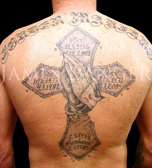 Great cross with memorials dates and praying hands with rosary tattoo