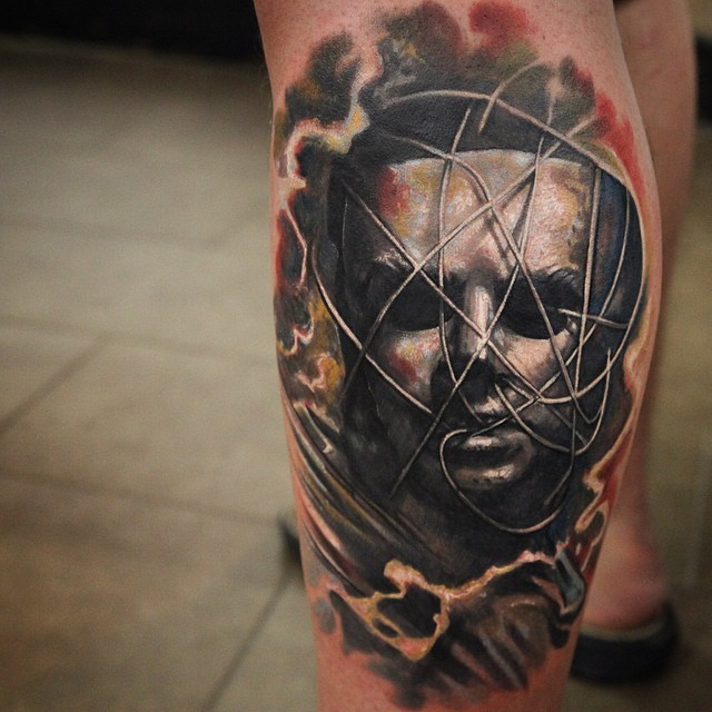 Great designed and colored big mystical mask tattoo on leg