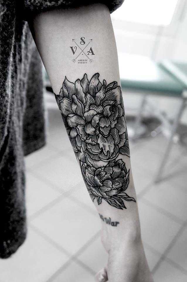 Great designed black and white floral tattoo with lettering on arm