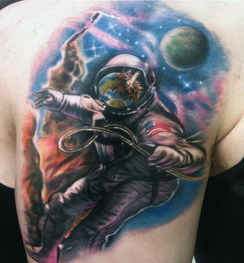 Great detailed big colored spaceman tattoo on upper arm