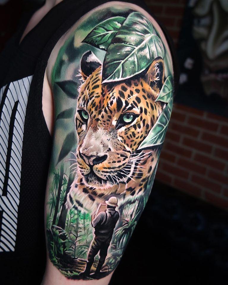 Great Jaguar and Explorer tattoo on shoulder