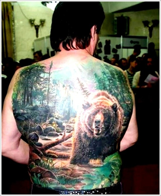 Great lovely grizzly in woods tattoo on whole back