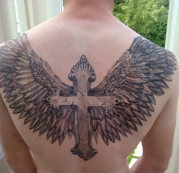 Great lovely winged cross tattoo on back