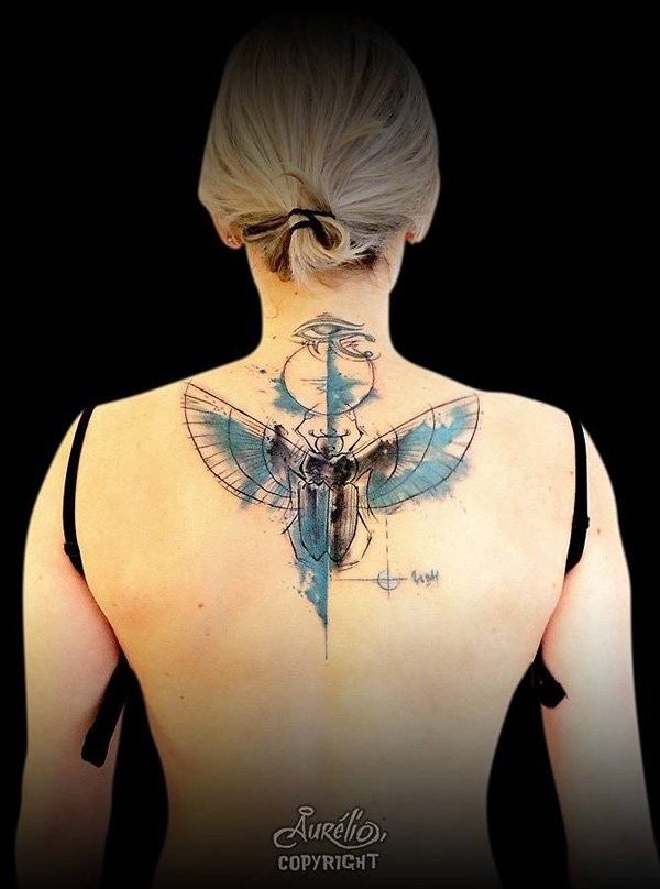 Great mystical colored and designed tattoo on upper back