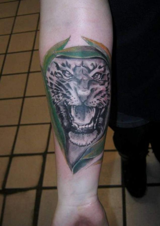 Great painted and detailed black ink roaring tiger tattoo on arm