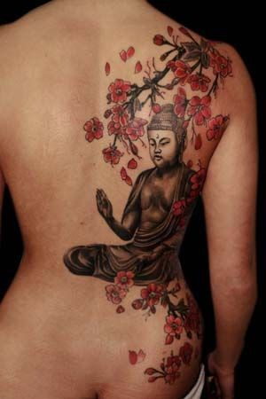 Great painted big Buddha statue under the tree tattoo on back