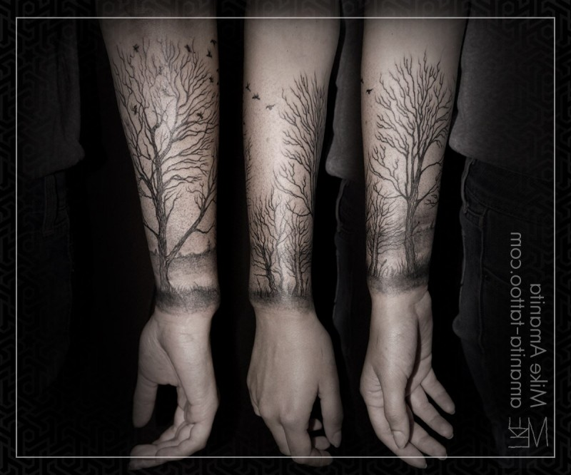 Great painted black ink old forest with birds tattoo on wrist