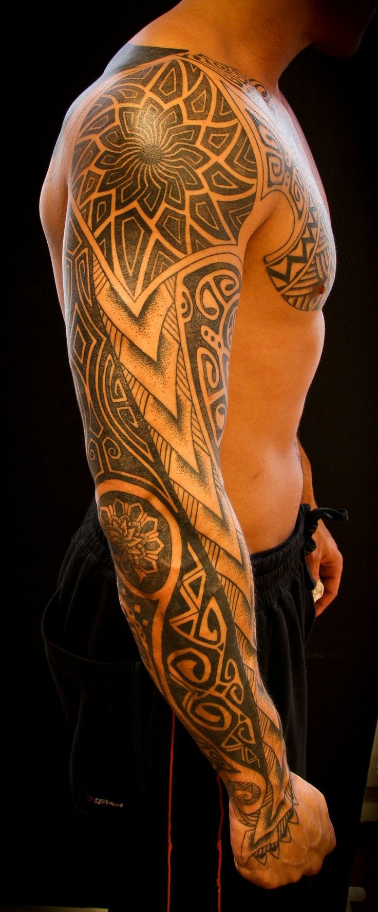 Great painted massive black ink Polynesian ornaments tattoo on sleeve