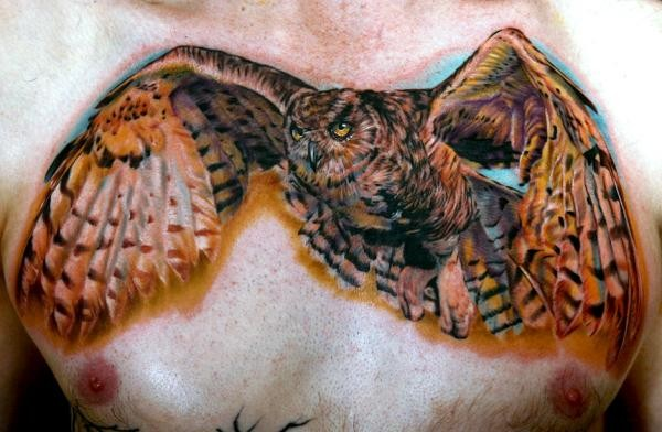 Great realistic flying owl tattoo on chest - Tattooimages.biz