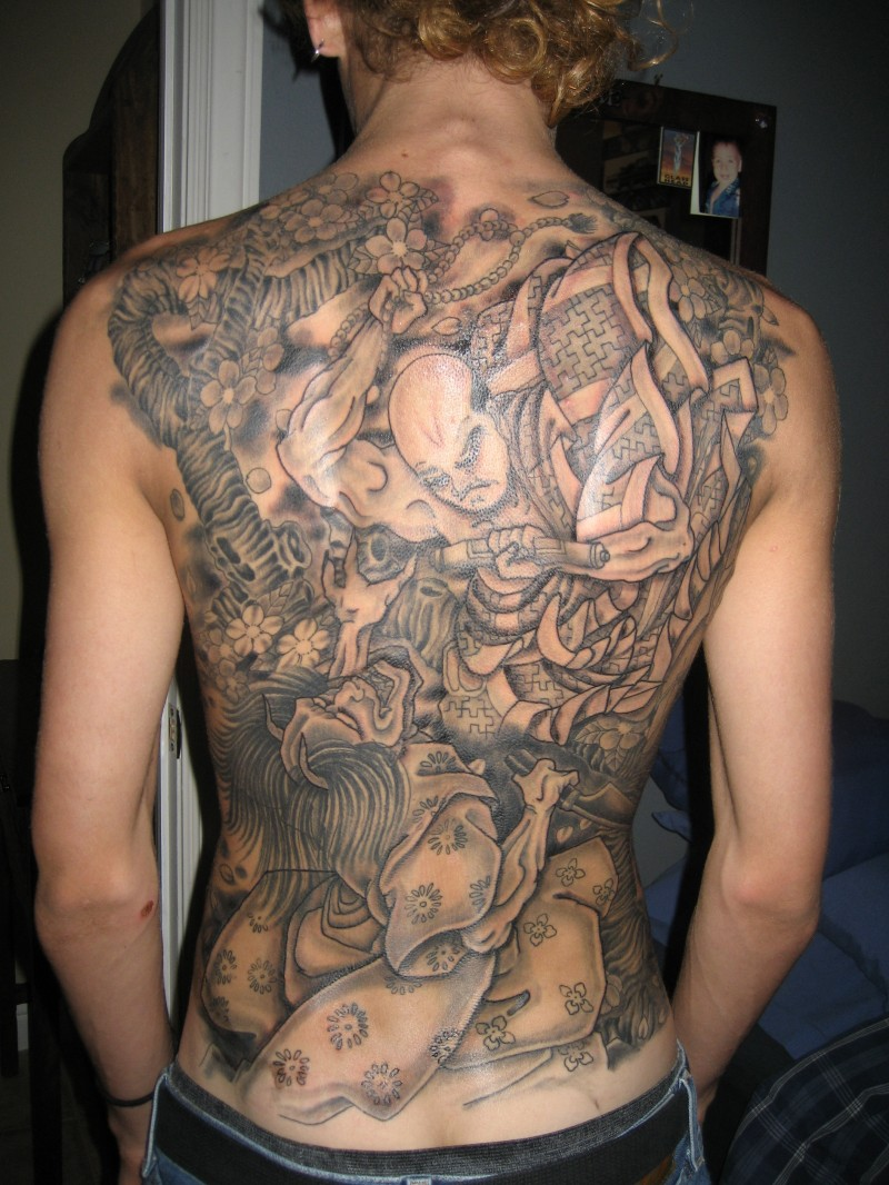 Great samurai and demon tattoo on back