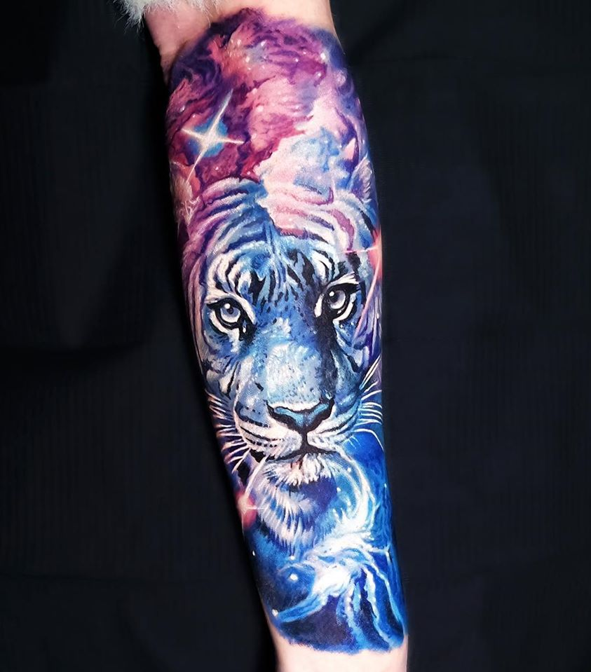 Great Space and Tiger tattoo on forearm