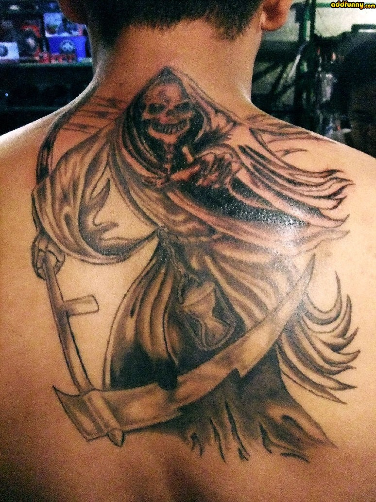Great terrible grim reaper tattoo on back