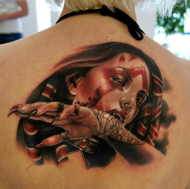 Great vampiress tattoo on upper back by moni marino