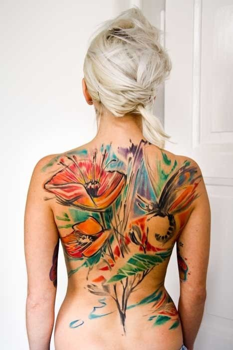 Great watercolor flowers with dragonfly tattoo on whole back
