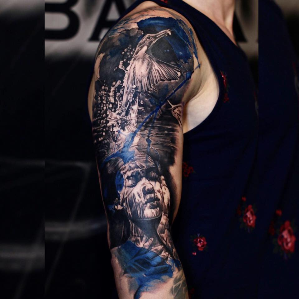 Great woman and bird tattoo in black white and blue colors