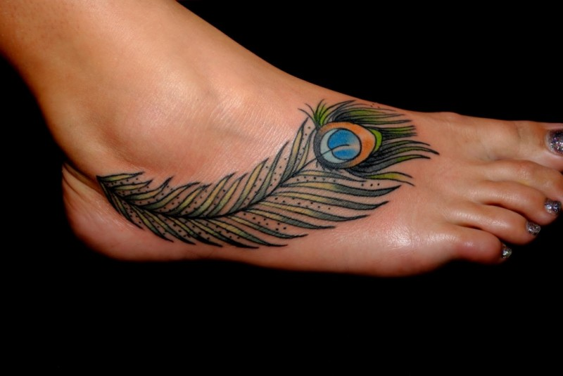 Green feather women foot tattoos