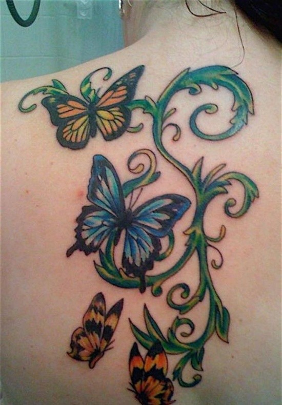green vine with butterflies tattoo on back. Black Bedroom Furniture Sets. Home Design Ideas