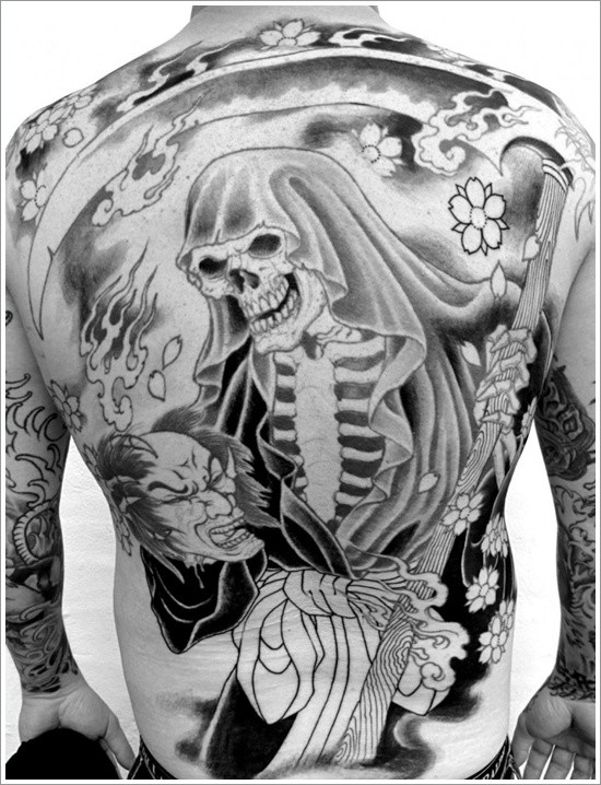 Grim reaper with a scythe in japanese style tattoo on back