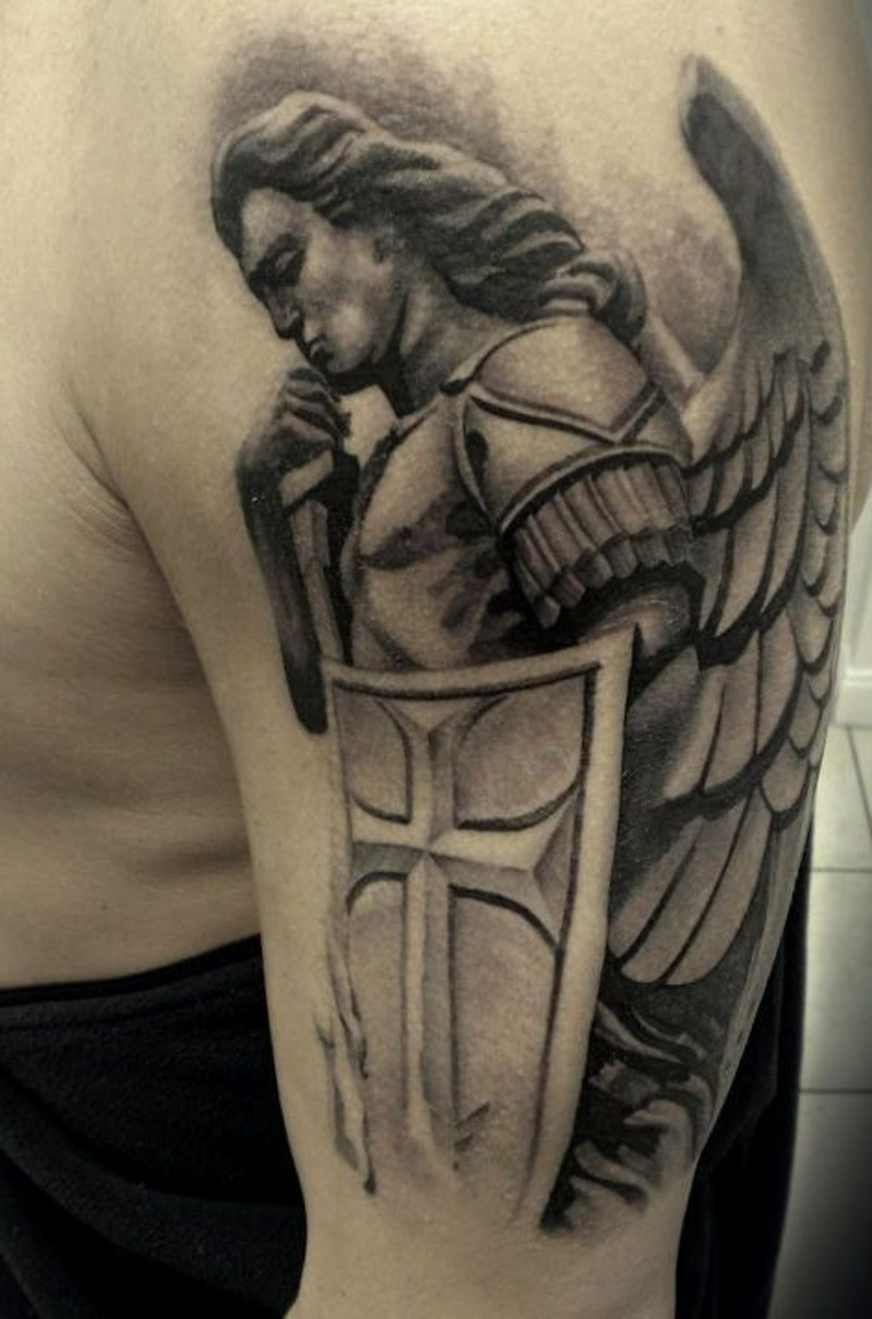 Guardian angel with shield tattoo on shoulder