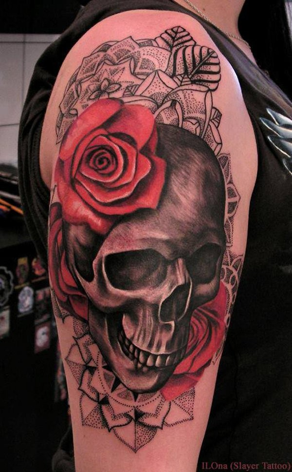 Half 3D half dot style colored shoulder tattoo of human skeleton stylized with flowers