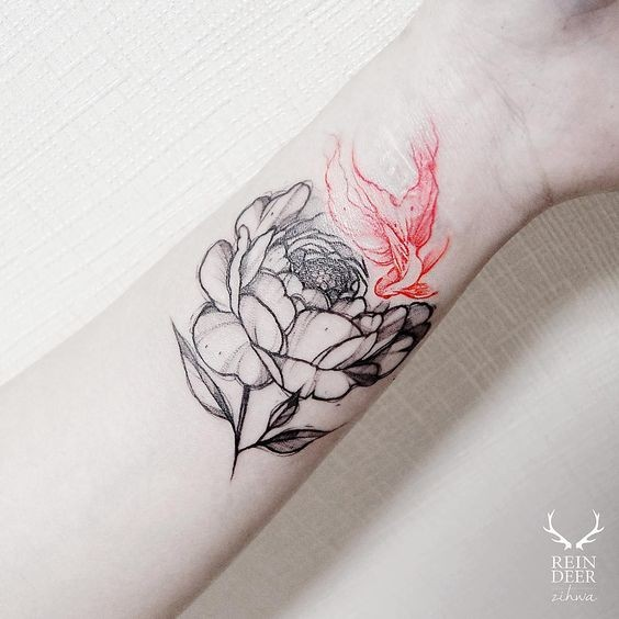 Half colored nice looking painted by Zihwa tattoo of flower with red leaf