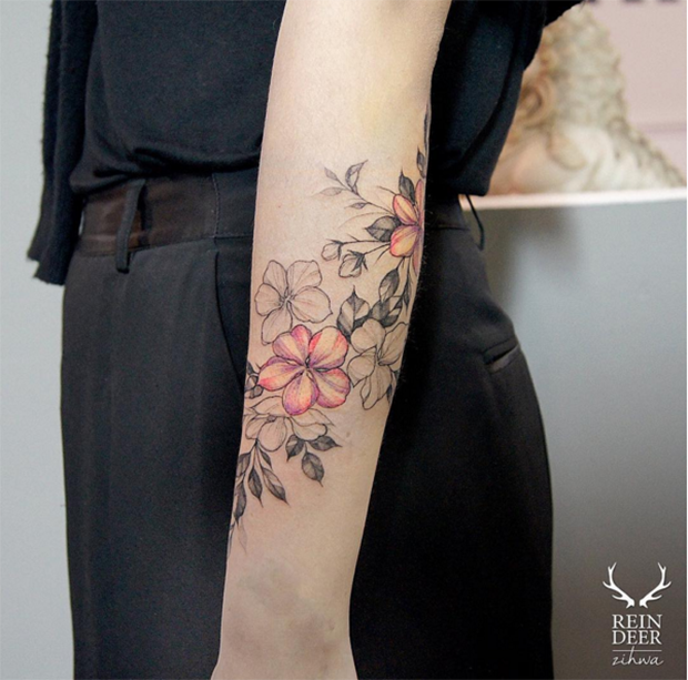 Half colored painted by Zihwa forearm tattoo of nice flowers