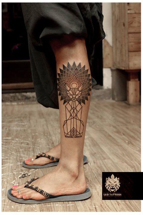 Half geometrical half dot style big leg tattoo of fantasy cat with big ornaments