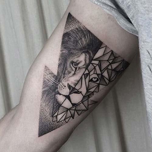 Half geometrical half dot style black ink biceps tattoo of lion head