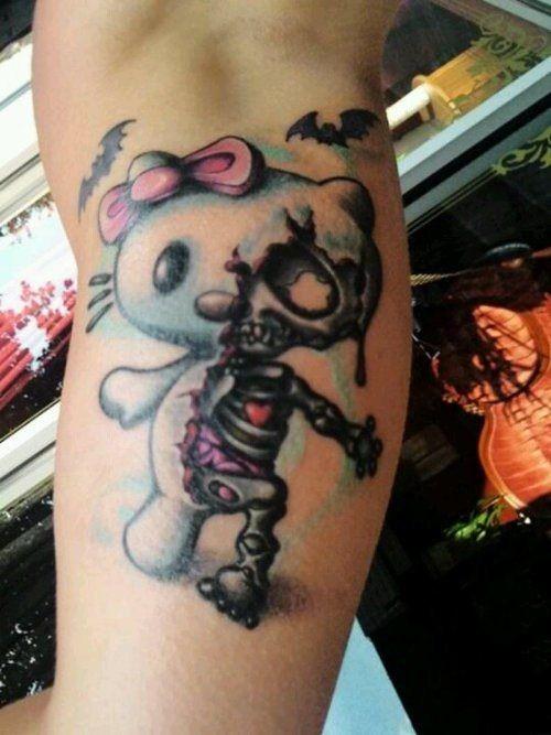 Half hello kitty half skeleton tattoo on arm