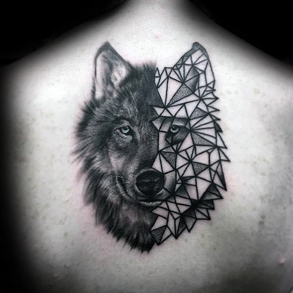 Half realistic half geometrical style back tattoo of wolf head