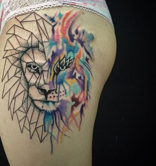 Half watercolor half geometrical style thigh tattoo of fantasy lion
