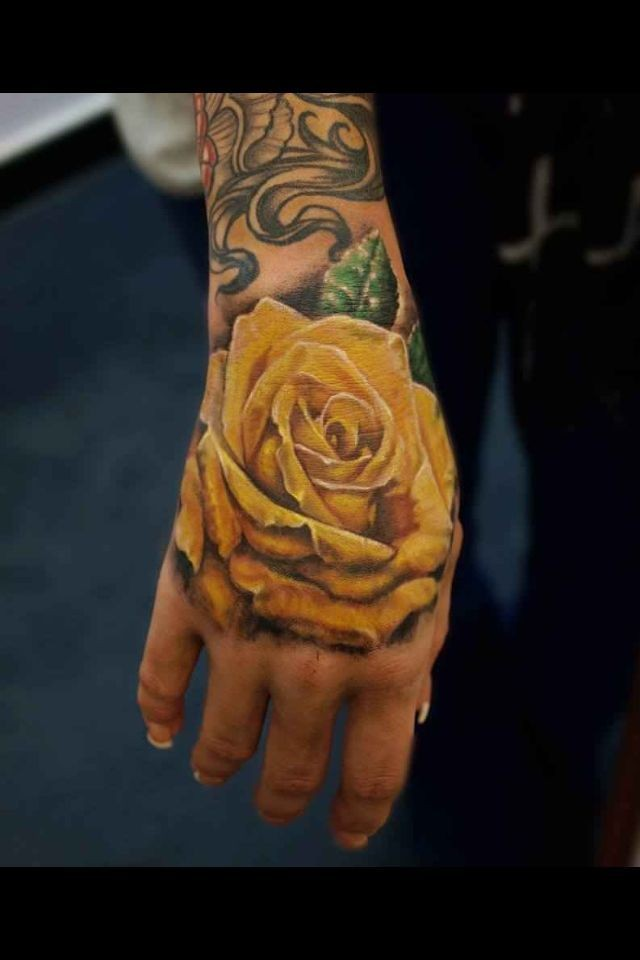 Hand tattoo with yellow rose