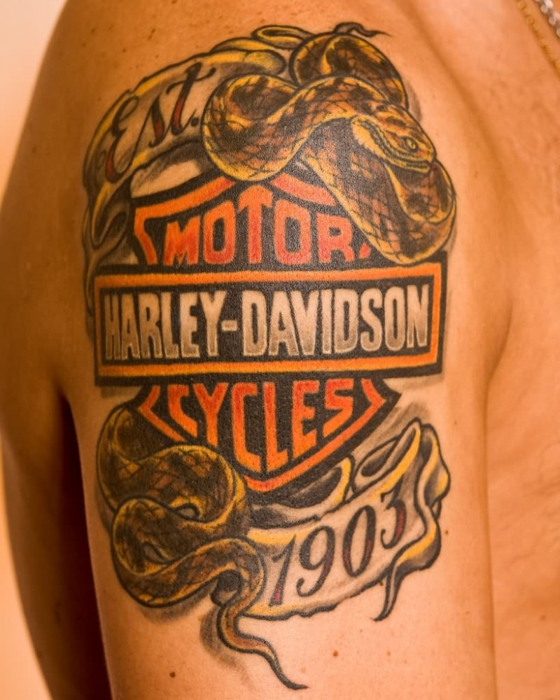 Harley davidson logo with snake tattoo on shoulder