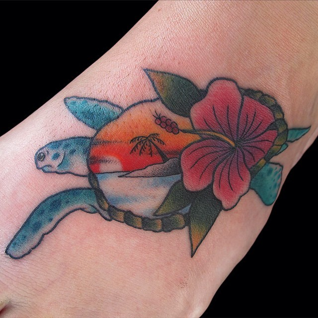 Hawaiian turtle decorated with hibiscus flower and paradise scene colored foot tattoo