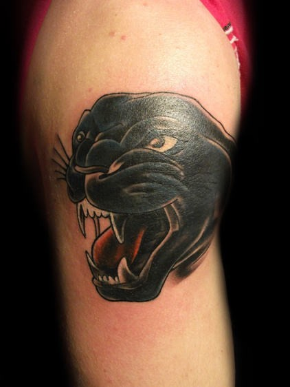 Head black panther tattoo on arm