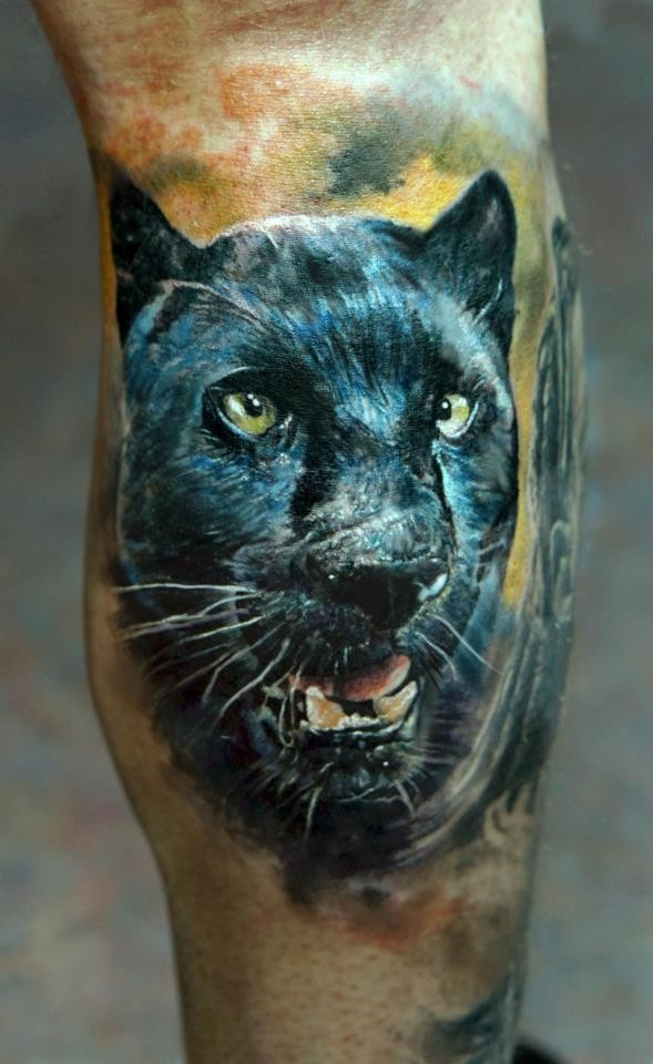 Head black panther tattoo on leg