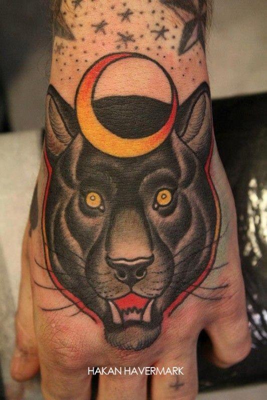 Head black panther tattoo on wrist by Hakan Havermark