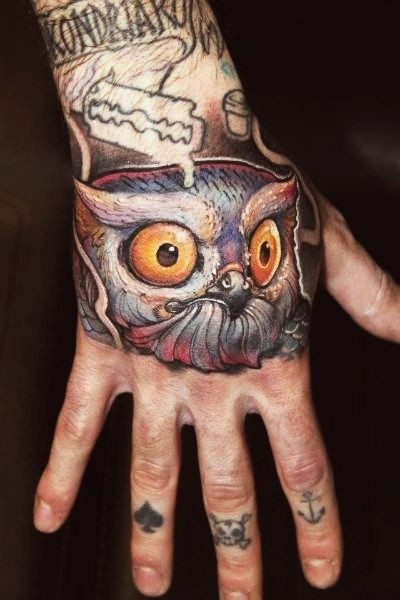 Head is of an owl tattoo on her arm