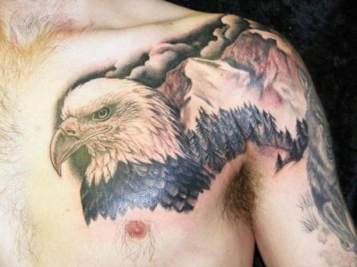 Head of an eagle and landscape tattoo on shoulder