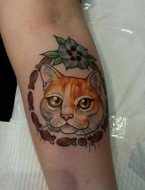 Head red cat tattoo on arm by Eddy Lou