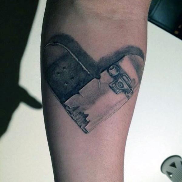 heart shaped broken skateboard tattoo on forearm in