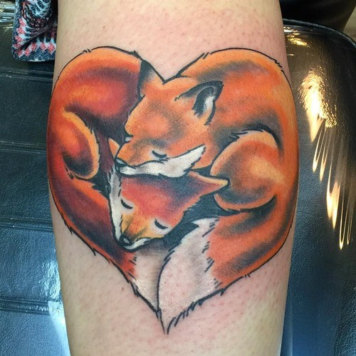Heart shaped pair of curled foxes naturally colored sentimental tattoo
