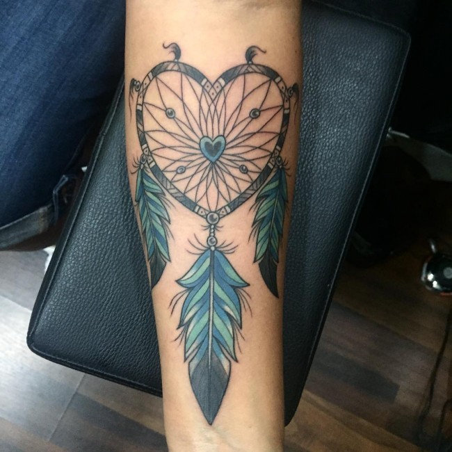 Heart shaped traditional American Indian dream catcher colored forearm length tattoo