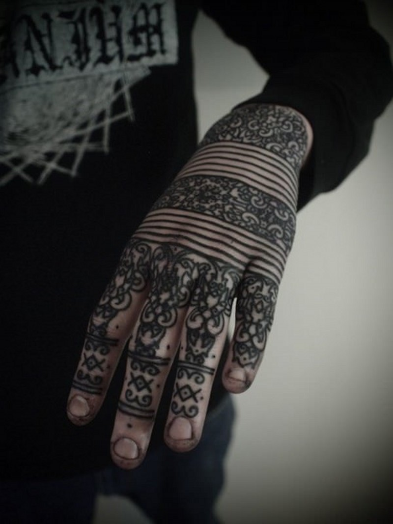 Henna style black ink hand tattoo of identic tribal ornaments and lines